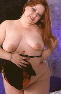 Fat busty redhead showing her large tits